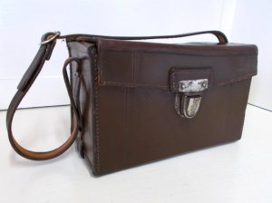 Vintage Camera Case 10 Valentine's Day Gifts Under $60 for the Traveler You Love- Lesbian Travel Guide- DopesOnTheRoad.com