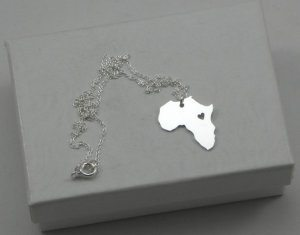 Africa Necklace 10 Pieces of Travel Jewelry To Inspire Wanderlust at Home- Lesbian Travel Guide- DopesOnTheRoad.com