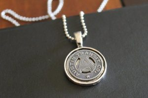 Austin City Transit Token 10 Pieces of Travel Jewelry To Inspire Wanderlust at Home- Lesbian Travel Guide- DopesOnTheRoad.com