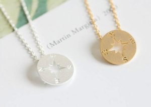 Minimal2BoHo Nautical Compass Necklace- 10 Pieces of Travel Jewelry To Inspire Wanderlust at Home- Lesbian Travel Guide- DopesOnTheRoad.com