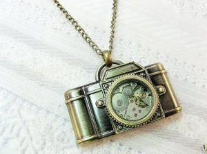 Vintage Camera Necklace 10 Pieces of Travel Jewelry To Inspire Wanderlust at Home- Lesbian Travel Guide- DopesOnTheRoad.com