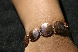 Vintage Coin Bracelet 10 Pieces of Travel Jewelry To Inspire Wanderlust at Home- Lesbian Travel Guide- DopesOnTheRoad.com
