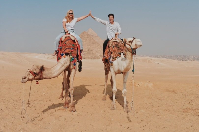 Lesbian couple on camels together in Egypt.