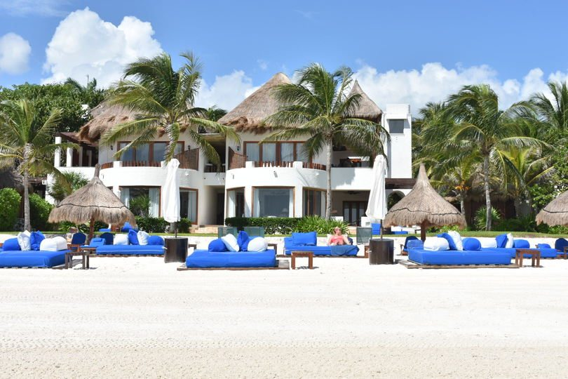 Woman laying on a sun bed at a resort in Playa del Carmen