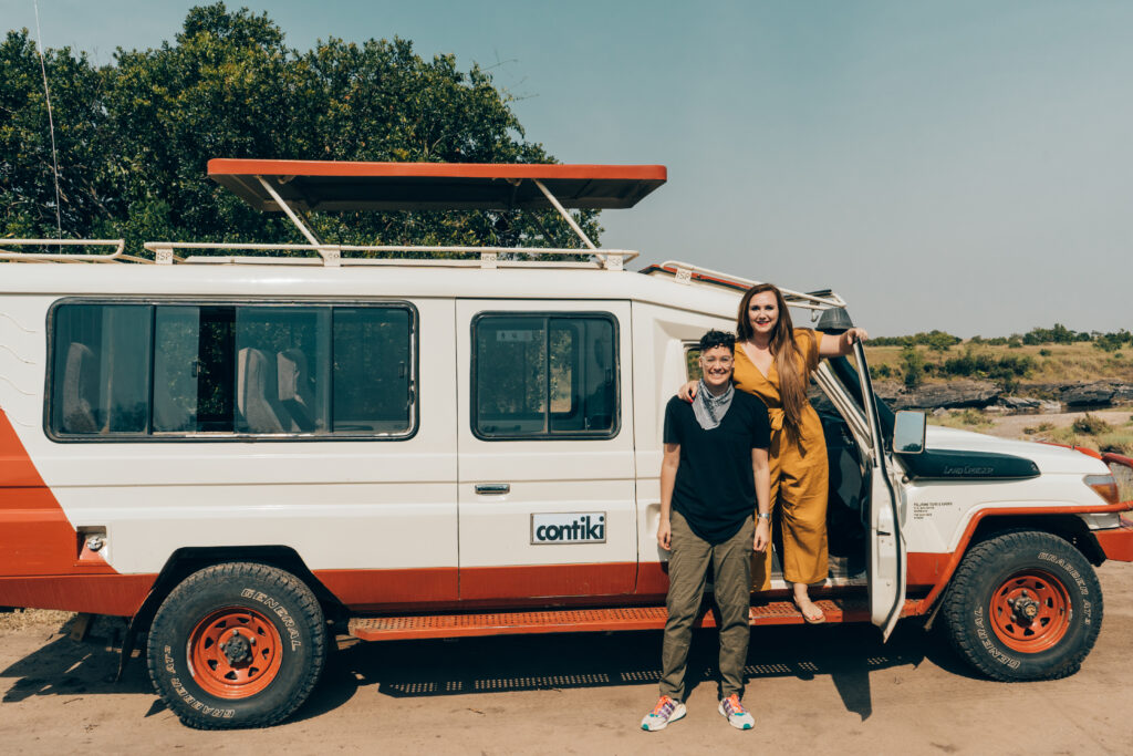 Lesbian-couple-tanzania-posing-with-safari-vehicle