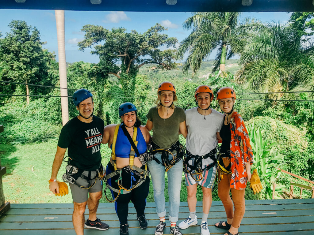 queer people dressed in helmets to zipline